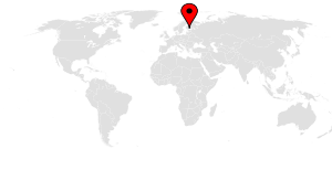 A map of the world with a pin on Finland